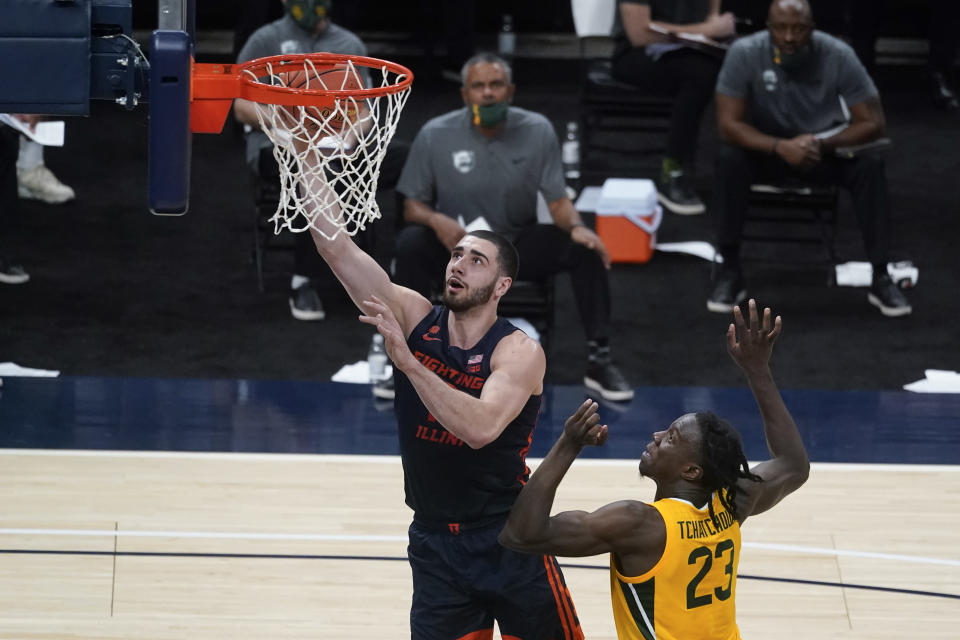 Illinois' Giorgi Bezhanishvili (15) shoots next to Baylor's Jonathan Tchamwa Tchatchoua (23) during the first half of an NCAA college basketball game Wednesday, Dec. 2, 2020, in Indianapolis. (AP Photo/Darron Cummings)