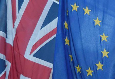 A Union flag flies next to the flag of the European Union in Westminster, London