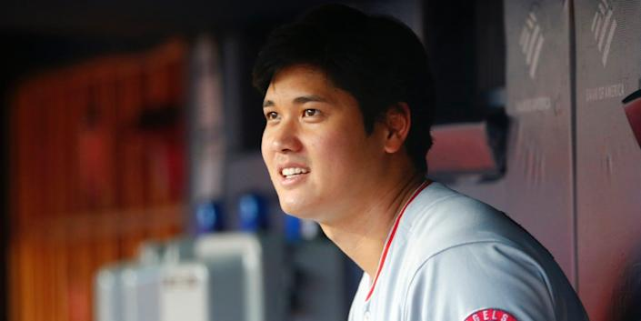 Shohei Ohtani looks out from the dugout.