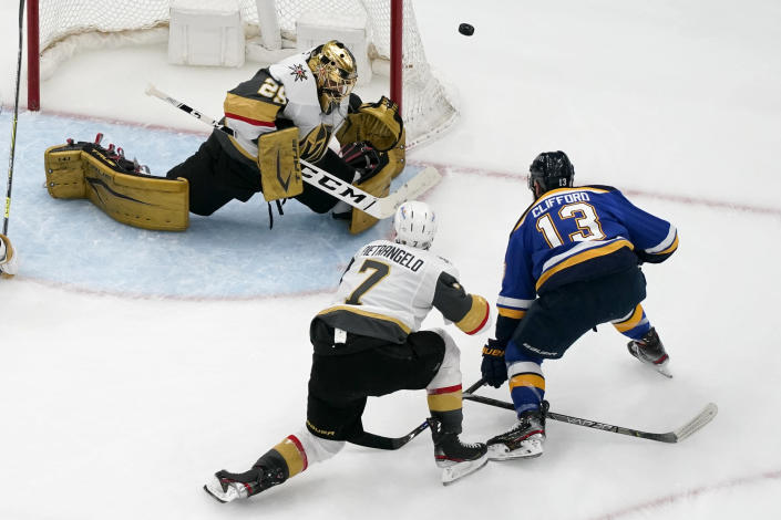 Vegas Golden Knights goaltender Marc-Andre Fleury (29) defects a shot from St. Louis Blues' Kyle Clifford (13) as Vegas Golden Knights' Alex Pietrangelo (7) watches during the third period of an NHL hockey game Wednesday, April 7, 2021, in St. Louis. (AP Photo/Jeff Roberson)