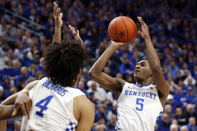 Kentucky's Immanuel Quickley (5) shoots near teammate Nick Richards (4) in the second half of an NCAA college basketball game against Mississippi in Lexington, Ky., Saturday, Feb. 15, 2020. Kentucky won 67-62. (AP Photo/James Crisp)