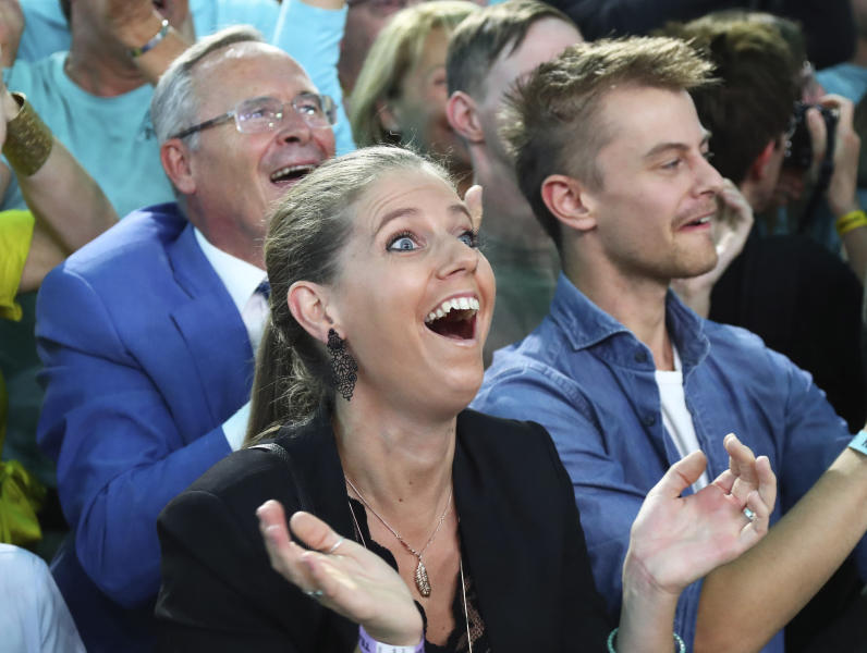 Supporters of former Austrian chancellor and top candidate of the Austrian People's Party, OEVP, Sebastian Kurz react during a party in Vienna, Germany, Sunday, Sept. 29, 2019. (AP Photo/Michael Sohn)