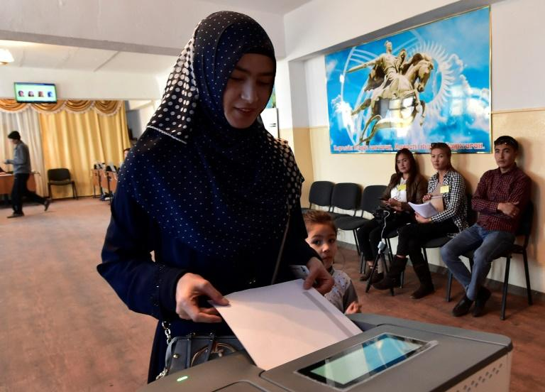Kyrgyzstan's Central Election Comission said turnout in the presidential election was around 56 percent