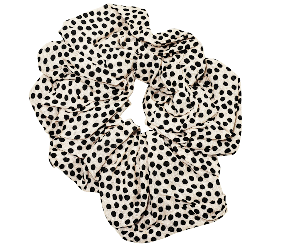 """<h3>Kitsch Brunch Scrunchie</h3><br>Black and white is a classic color combo, and the teeny-tiny polka dots feel fun and festive without being seasonally exclusive.<br><br><strong>Kitsch</strong> Brunch Scrunchie - Dot, $, available at <a href=""""https://go.skimresources.com/?id=30283X879131&url=https%3A%2F%2Fmykitsch.com%2Fproducts%2Fbrunch-scrunchie-dot%3Fvariant%3D31496490123298%26currency%3DUSD%26utm_source%3Dgoogle%26utm_medium%3Dcpc%26utm_campaign%3DShopping_BRANDED%26gclid%3DEAIaIQobChMIlM-T4Yio6wIVgY3ICh2pbwMREAQYASABEgL1LvD_BwE"""" rel=""""nofollow noopener"""" target=""""_blank"""" data-ylk=""""slk:Kitsch"""" class=""""link rapid-noclick-resp"""">Kitsch</a>"""