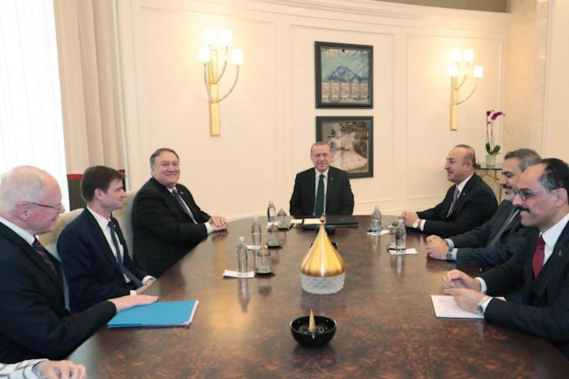 A photo made available by the Turkish Presidential Press Office shows US Secretary of State Mike Pompeo (3-L) during a meeting with Turkish President Recep Tayyip Erdogan (C) and Turkish Foreign Minister Mevlut Cavusoglu (3-R) in Ankara on Wednesday (EPA)