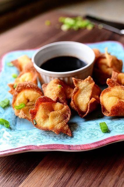 """<p>Because these little guys are so easy to make, you can churn out a big batch in no time. They'll add a lovely crunch to your appetizer spread.</p><p><strong><a href=""""https://www.thepioneerwoman.com/food-cooking/recipes/a11433/cream-cheese-wontons/"""" rel=""""nofollow noopener"""" target=""""_blank"""" data-ylk=""""slk:Get the recipe."""" class=""""link rapid-noclick-resp"""">Get the recipe.</a></strong></p><p><strong><a class=""""link rapid-noclick-resp"""" href=""""https://go.redirectingat.com?id=74968X1596630&url=https%3A%2F%2Fwww.walmart.com%2Fbrowse%2Fhome%2Ffood-prep%2F4044_623679_133020_642199%3Ffacet%3Dbrand%253AThe%2BPioneer%2BWoman&sref=https%3A%2F%2Fwww.thepioneerwoman.com%2Ffood-cooking%2Fmeals-menus%2Fg34272733%2Fchristmas-party-appetizers%2F"""" rel=""""nofollow noopener"""" target=""""_blank"""" data-ylk=""""slk:SHOP MIXING BOWLS"""">SHOP MIXING BOWLS</a><br></strong></p>"""