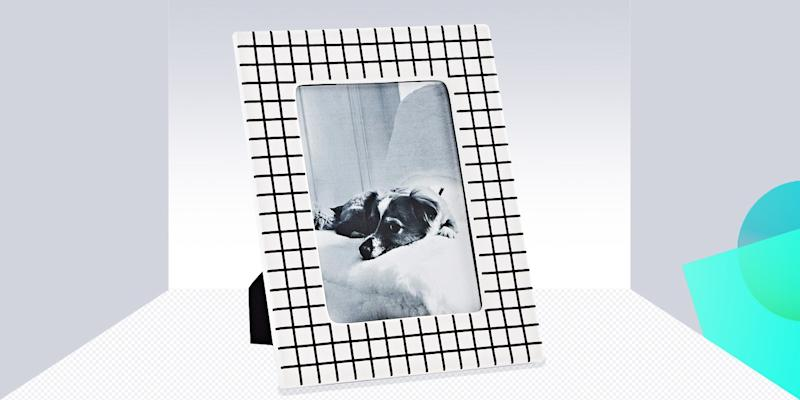 """It's about time you got your photos off your phone and into the cool graphic frames they deserve. SHOP NOW: Grid Frame in Black and White by Now House by Jonathan Adler, 5""""x 7"""", $58, amazon.com"""