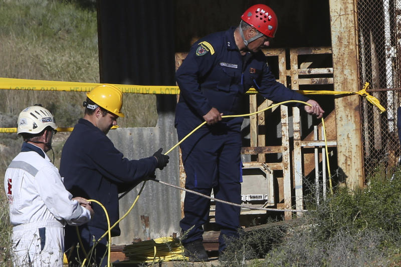 Cypriot special Rescue Forces loaded a special camera inside a flooded mineshaft where two female bodies were found, outside of Mitsero village near capital Nicosia, Cyprus, Monday, April 22, 2019. Police on the east Mediterranean island nation, along with the help of the fire service, are conducting the search Monday in the wake of last week's discovery of the bodies in the abandoned mineshaft and the disappearance of the six year-old daughter of one of the victims. (AP Photo/Petros Karadjias)
