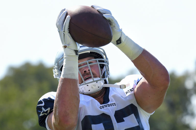 FILE - In this July 29, 2019, file photo, Dallas Cowboys tight end Jason Witten catches the ball from a passing machine at the NFL football team's training camp in Oxnard, Calif. The Cowboys and Los Angeles Rams meet Saturday, Aug. 17, 2019, in Honolulu, a place that used to be a regular NFL stop for the Pro Bowl. The first exhibition game in Hawaii since 1976 also figures to be Wittens return after a year in retirement as a broadcaster. (AP Photo/Michael Owen Baker, File)