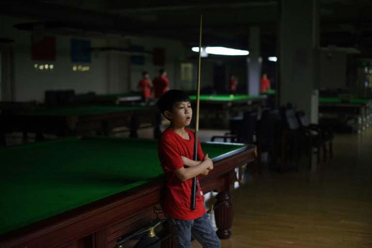 Students at the Beijing snooker school -- the first of its kind in China -- practise snooker eight hours a day in the hopes of following in the footsteps of their idol Ding Junhui