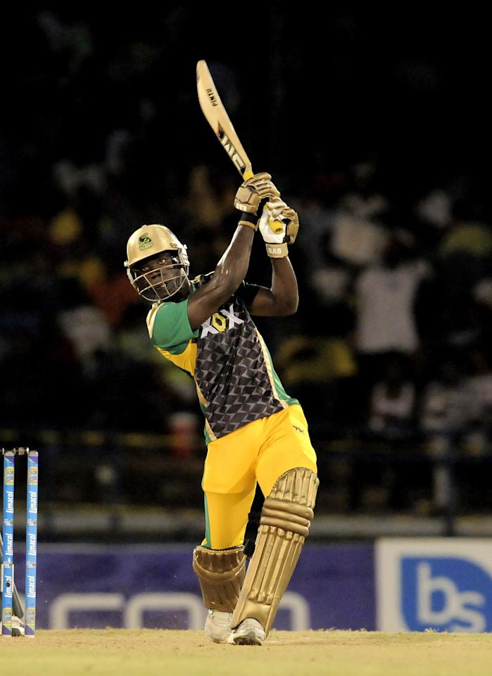 PORT OF SPAIN, TRINIDAD AND TOBAGO - AUGUST 24:  Chadwick Walton of Jamaica Tallawahs hits a 6 against Guyana Amazon Warriors during the Final of the Caribbean Premier League between Guyana Amazon Warriors v Jamaica Tallawahs at Queens Park Oval on August 24, 2013 in Port of Spain, Trinidad and Tobago. (Photo by Randy Brooks/Getty Images Latin America for CPL)