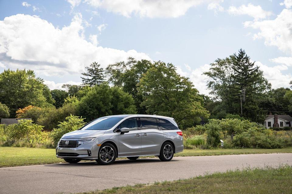 "<p>While its name may suggest that it will turn the next family road trip into a grand adventure, the <a href=""https://www.caranddriver.com/honda/odyssey-2021"" rel=""nofollow noopener"" target=""_blank"" data-ylk=""slk:2021 Honda Odyssey"" class=""link rapid-noclick-resp"">2021 Honda Odyssey</a> is far more likely to be appreciated for its day-to-day practicality. Its spacious and reconfigurable interior is perfect for hauling kids, cargo, or both and it offers a <a href=""https://www.caranddriver.com/features/g15086526/honda-odyssey-why-buy/"" rel=""nofollow noopener"" target=""_blank"" data-ylk=""slk:collection of inventive features"" class=""link rapid-noclick-resp"">collection of inventive features</a> that are intended to make family life a little easier. The Odyssey also drives far more pleasantly than its dowdy shape suggests and its silky-smooth V-6 engine pulls strong for highway merging and passing. Honda also makes plenty of safety features standard across the Odyssey lineup, but its main rivals—the <a href=""https://www.caranddriver.com/chrysler/pacifica"" rel=""nofollow noopener"" target=""_blank"" data-ylk=""slk:Chrysler Pacifica"" class=""link rapid-noclick-resp"">Chrysler Pacifica</a> and <a href=""https://www.caranddriver.com/toyota/sienna"" rel=""nofollow noopener"" target=""_blank"" data-ylk=""slk:Toyota Sienna"" class=""link rapid-noclick-resp"">Toyota Sienna</a>—do the same and also offer optional all-wheel drive. </p><p><a class=""link rapid-noclick-resp"" href=""https://www.caranddriver.com/honda/odyssey-2021"" rel=""nofollow noopener"" target=""_blank"" data-ylk=""slk:Review, Pricing, and Specs"">Review, Pricing, and Specs</a></p>"