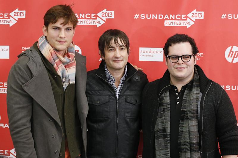 """From left, actor Ashton Kutcher, who portrays Steve Jobs, director Joshua Michael Stern, and actor Josh Gad, who portrays Steve Wozniak, pose together at the premiere of """"jOBS"""" during the 2013 Sundance Film Festival on Friday, Jan. 25, 2013 in Park City, Utah. (Photo by Danny Moloshok/Invision/AP)"""