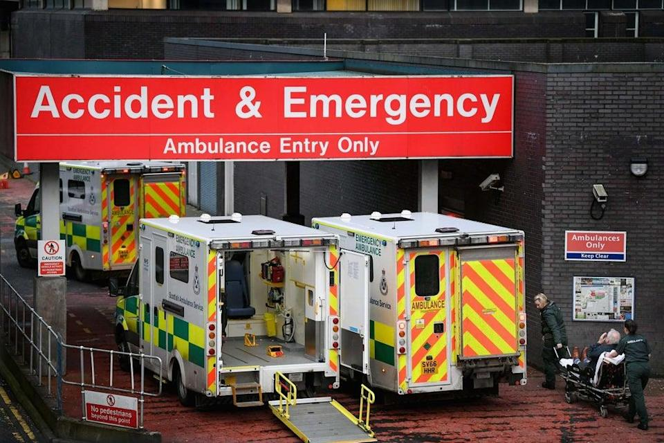 Emergency services are under 'acute pressure' amid a surge in Covid-19 cases (picture shows ambulances at Glasgow Royal Hospital)  (Getty)