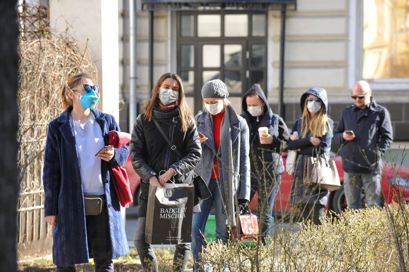 People queue before undergoing medical tests for coronavirus disease at a laboratory in Moscow