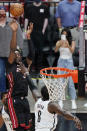 Miami Heat center Bam Adebayo, rear, makes the winning shot against Brooklyn Nets forward Jeff Green (8) at the end of the second half of an NBA basketball game, Sunday, April 18, 2021, in Miami. (AP Photo/Wilfredo Lee)