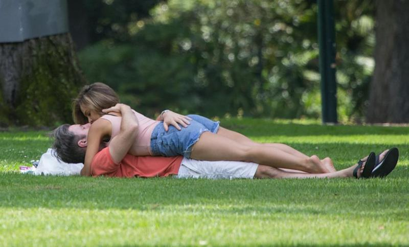 Carly and Troy from the new season of Married At First Sight are seen holding hands and kissing in a park in Melbourne. Source: Splash