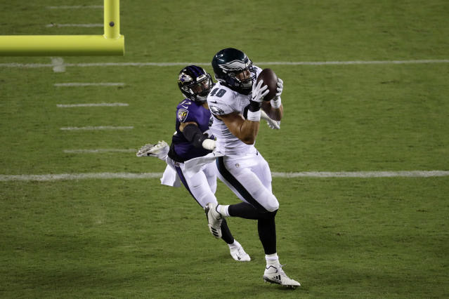 Philadelphia Eagles' Alex Ellis, right, catches a touchdown pass against Baltimore Ravens' Bennett Jackson (33) during the second half of a preseason NFL football game Thursday, Aug. 22, 2019, in Philadelphia. (AP Photo/Michael Perez)