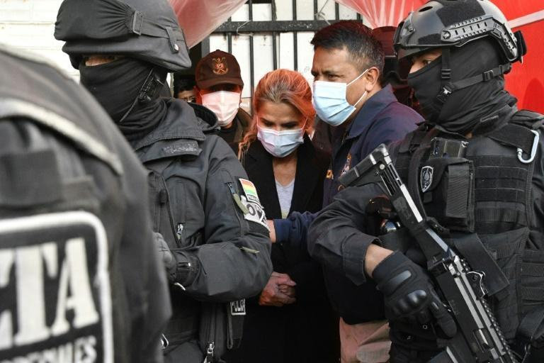 Former Bolivian interim president Jeanine Anez is escorted by police members of the Special Force against Crime after being arrested in La Paz, on March 13, 2021