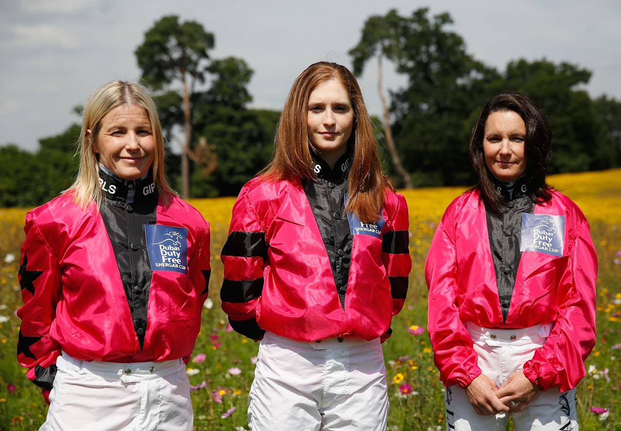 ASCOT, ENGLAND - AUGUST 08: Cathy Gannon from Ireland (L), Rosie Napravnik from the USA (C) and Lisa Allpress from New Zealand (R), riding for 'The Girls Team' pose for a photograph during a photocall ahead of the Dubai Duty Free Shergar Cup at Coworth Park Polo Club on August 8, 2013 in Ascot, England. (Photo by Harry Engels/Getty Images)