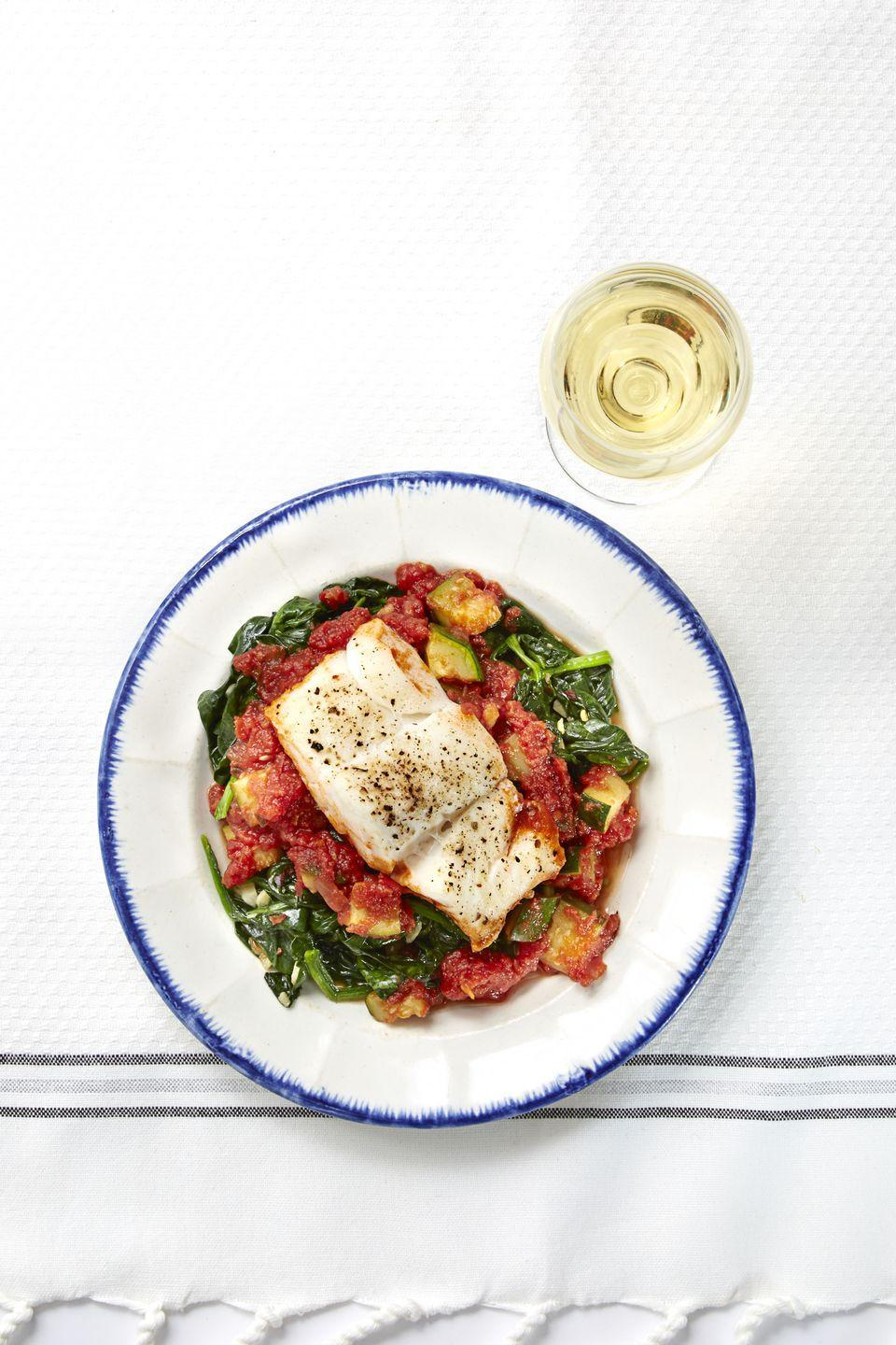 """<p>This month, we're celebrating a delicious <a href=""""https://www.womansday.com/health-fitness/nutrition/a30550619/best-diets-for-women-over-50/"""" rel=""""nofollow noopener"""" target=""""_blank"""" data-ylk=""""slk:way to eat that benefits"""" class=""""link rapid-noclick-resp"""">way to eat that benefits</a> your heart, your brain, and, well, pretty much your whole body: the <a href=""""https://www.goodhousekeeping.com/food-recipes/healthy/g4357/mediterranean-diet-meal-plan/"""" rel=""""nofollow noopener"""" target=""""_blank"""" data-ylk=""""slk:Mediterranean Diet"""" class=""""link rapid-noclick-resp"""">Mediterranean Diet</a>. The eating style emphasizes fruit and veggies, whole grains, healthy fats, and lean and plant-based proteins (particularly fish). Here are the basics:</p><p>•<strong>Make smart pantry swaps. </strong>Switch out white rice and pasta for whole-grain options like quinoa, farro, brown rice, and whole-wheat or bean-based pasta. Use olive oil instead of butter for its healthy fats.</p><p>•<strong>Eat more fish, less meat.</strong> Aim to eat heart-healthy seafood at least twice a week; grilled or baked is better for you than fried. Minimize red meat and focus on lean poultry or pulses like beans and lentils.</p><p>•<strong>Be adventurous with produce.</strong> Since this way of eating emphasizes plant foods, nudge yourself out of your comfort zone and pick up unfamiliar fruits and veggies from the store, then look up recipe ideas.</p><p><strong><em>Start by trying the recipe for <a href=""""https://www.goodhousekeeping.com/food-recipes/a32410/mediterranean-cod-recipe-ghk0515/"""" rel=""""nofollow noopener"""" target=""""_blank"""" data-ylk=""""slk:Mediterranean Cod"""" class=""""link rapid-noclick-resp"""">Mediterranean Cod</a>.</em></strong><br></p>"""