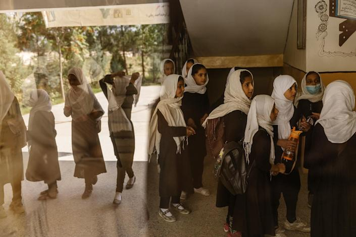 """Schoolgirls wait for a class in Kabul on Sept. 15.<span class=""""copyright"""">Victor J. Blue—The New York Times/Redux</span>"""