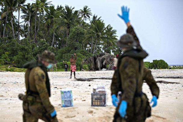 PHOTO: Australian Army soldiers from the Royal Australian Regiment deliver food and supplies to three stranded sailors from the Federated States of Micronesia following a search and rescue mission, to Pikelot Island in Micronesia, Aug. 3, 2020. (AUSTRALIAN DEFENCE FORCE HANDOUT)