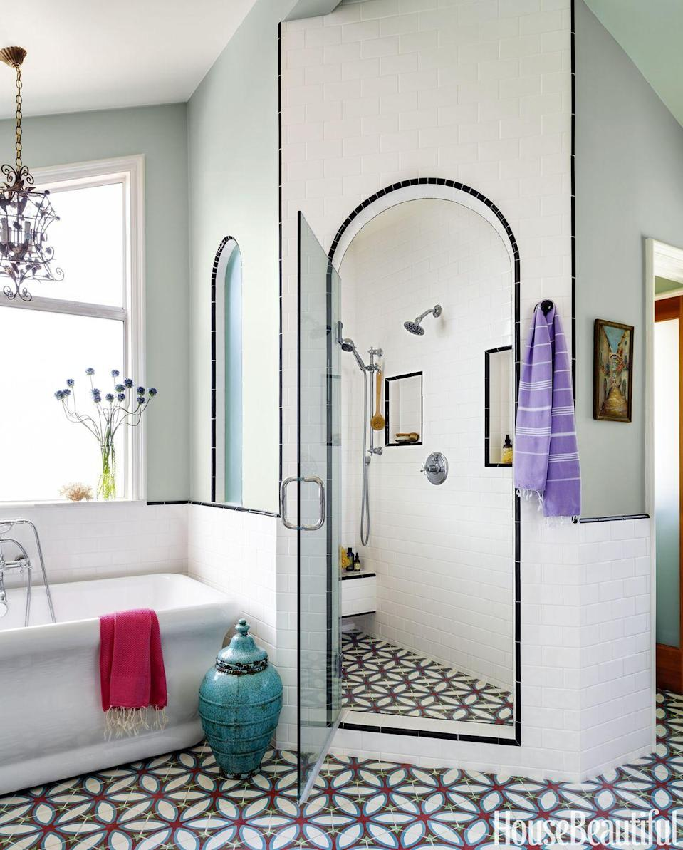 """<p>The tile in <a href=""""https://www.housebeautiful.com/room-decorating/bathrooms/a3979/bohemian-california-bathroom/"""" rel=""""nofollow noopener"""" target=""""_blank"""" data-ylk=""""slk:this 1970s beach house bathroom"""" class=""""link rapid-noclick-resp"""">this 1970s beach house bathroom</a> is similar to that of a cement floor in Spain, but the pattern is based on a block print from India.</p>"""