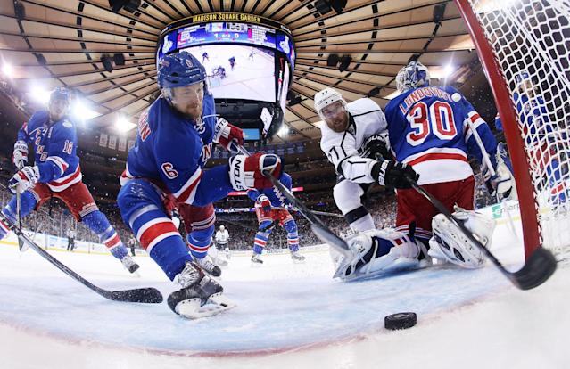 AP10ThingsToSee- New York Rangers defenseman Anton Stralman (6) reaches to save the puck from crossing the goal line as Los Angeles Kings center Jeff Carter (77) tries to score from behind New York Rangers goalie Henrik Lundqvist (30) in the first period during Game 4 of the NHL hockey Stanley Cup finals, Wednesday, June 11, 2014, in New York. (AP Photo/Bruce Bennett, Pool)