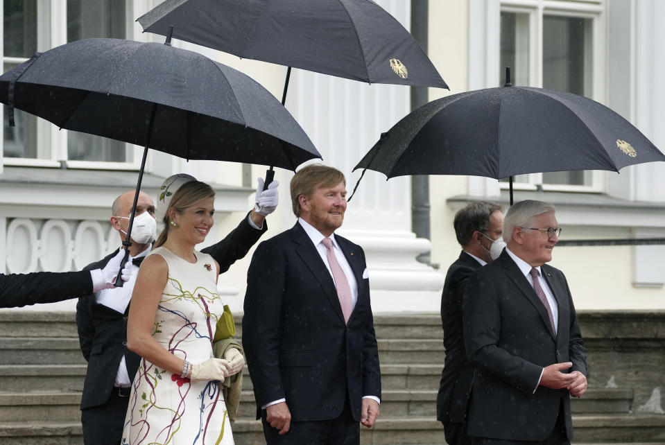 German President Frank-Walter Steinmeier, front right, welcomes Dutch King Willem-Alexander, center, and his wife Queen Maxima, front left, with military honors for a meeting in Berlin, Germany, Monday, July 5, 2021. The Royals arrived in Germany for a three-day visit that was delayed from last year because of the coronavirus pandemic. (AP Photo/Michael Sohn)