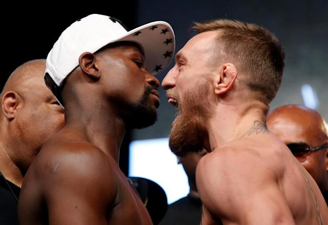 Undefeated boxer Floyd Mayweather Jr. (L) of the U.S. and UFC lightweight champion Conor McGregor of Ireland face off during their official weigh-in at T-Mobile Arena in Las Vegas, Nevada, U.S. on August 25, 2017. (Reuters)