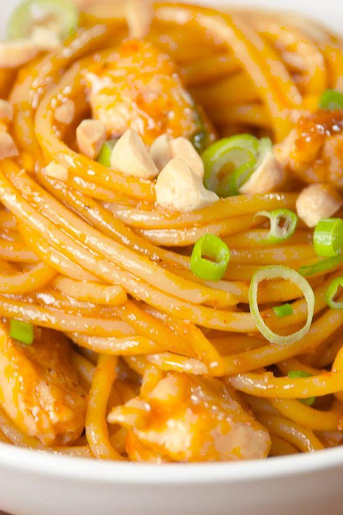 """<p>This easy dinner comes together in minutes and delivers a spicy kick.</p><p>Get the recipe from <a href=""""https://www.delish.com/cooking/recipe-ideas/recipes/a51063/kung-pao-spaghetti-recipe/"""" rel=""""nofollow noopener"""" target=""""_blank"""" data-ylk=""""slk:Delish"""" class=""""link rapid-noclick-resp"""">Delish</a>.</p>"""