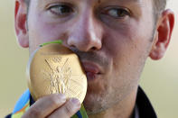 <p>Gabriele Rossetti of Italy kisses his gold medal during the victory ceremony for the men's skeet gold medal match at the Olympic Shooting Center during the Summer Olympics in Rio de Janeiro, Brazil, Saturday, Aug. 13, 2016. (AP Photo/Hassan Ammar) </p>