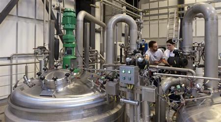 Novo Nordisk employees control a kettle at an insulin production in a plant in Kalundborg