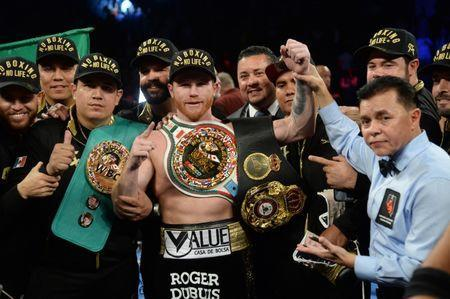 Sep 15, 2018; Las Vegas, NV, USA; Canelo Alvarez celebrates after defeating Gennady Golovkin in their middleweight world championship boxing match at T-Mobile Arena. Alvarez won via majority decision. Mandatory Credit: Joe Camporeale-USA TODAY Sports