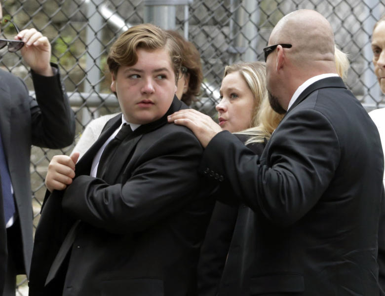 "FILE - In this Thursday, June 27, 2013 file photo, Michael Gandolfini, left, son of James Gandolfini, arrives for the funeral service of his father, star of ""The Sopranos,"" in New York's the Cathedral Church of Saint John the Divine. James Gandolfini left the bulk of his estimated $70 million estate to his 13-year-old son, Michael, and infant daughter Liliana. (AP Photo/Richard Drew, File)"