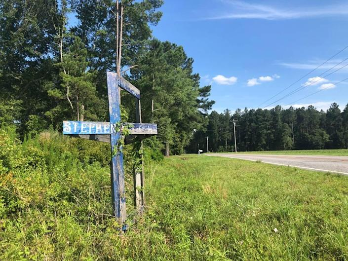 A wooden memorial on the side of Sandy Run Road, where 19-year-old Stephen Smith was found dead in 2015.