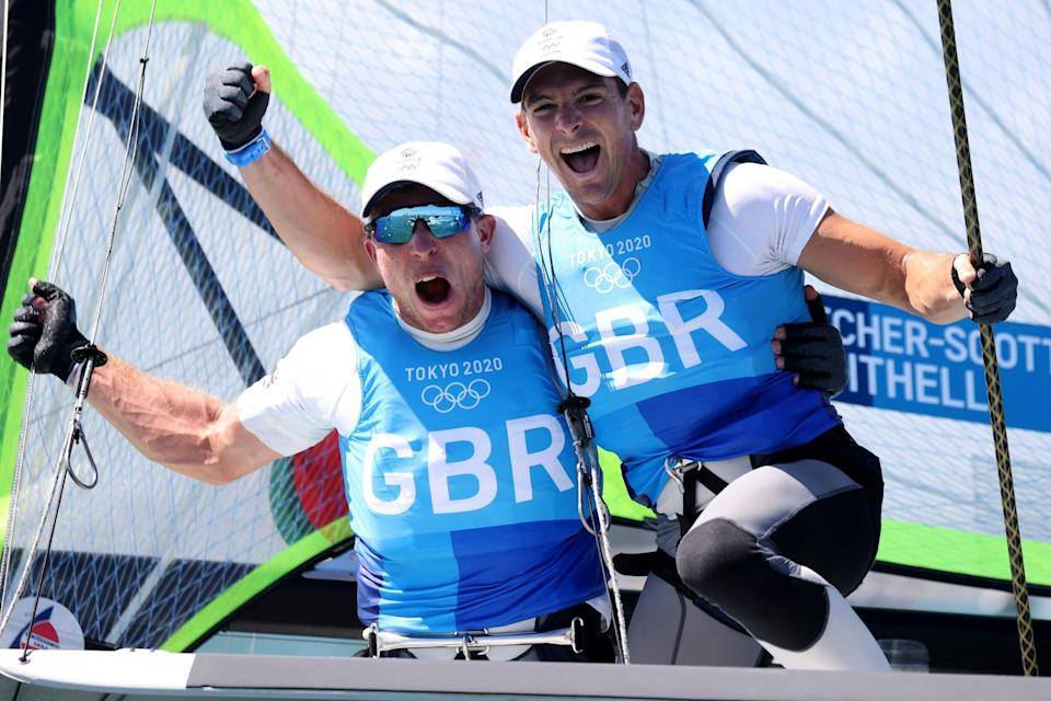 <p>Dylan Fletcher (right) and Stuart Bithell of Team Great Britain raise their fists in victory as they win gold in the Men's Skiff 49er class at Enoshima Yacht Harbour on August 3.</p>