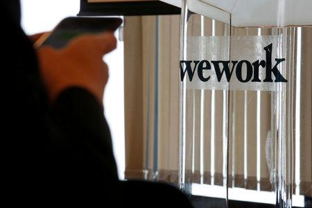 FILE PHOTO -  A guest attends the opening ceremony of WeWork Hong Kong flagship location in Hong Kong, China