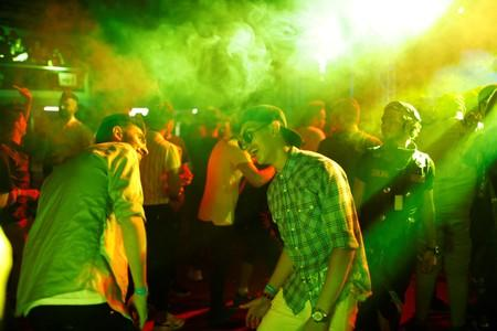 Young people dance as they attend electronic music concert with western tunes at closed Hall in Shaab Stadium for the first time in Baghdad