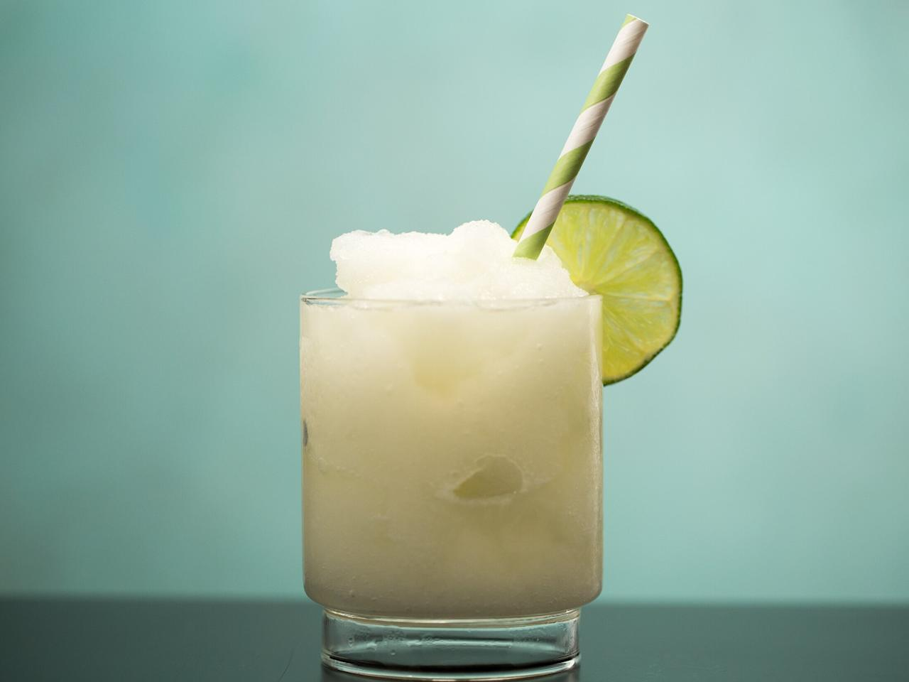 """<p>It's time to let go of the sweet and sour mix. These easy margaritas are mostly sour with a bit of sweetness and make your mouth water before you even take a sip. It's not overly sweet and heavy, but refreshing and even a little potent. Squeezing your own lime juice makes all the difference, so don't take any bottled shortcuts. </p> <p><a href=""""https://www.myrecipes.com/recipe/classic-frozen-margarita-0"""">Classic Frozen Margarita Recipe</a></p>"""