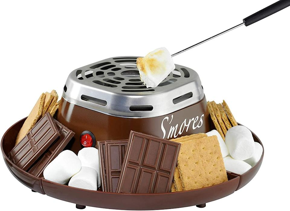 "<br><br><strong>Nostalgia</strong> Indoor Electric Stainless Steel S'mores Maker, $, available at <a href=""https://amzn.to/33ddsbI"" rel=""nofollow noopener"" target=""_blank"" data-ylk=""slk:Amazon"" class=""link rapid-noclick-resp"">Amazon</a>"