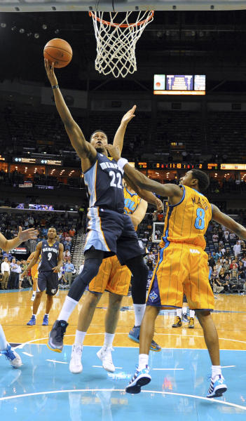 Memphis Grizzlies forward Rudy Gay (22) shoots over New Orleans Hornets guard Roger Mason (8) in the first half of an NBA basketball game in New Orleans, Friday Dec 7, 2012. (AP Photo/Stacy Revere)