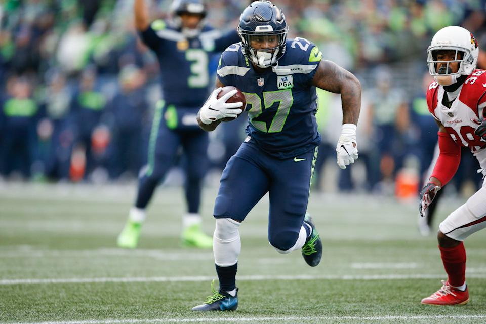 Mike Davis, seen here last year with Seattle, just bought his mom a house. (Getty)