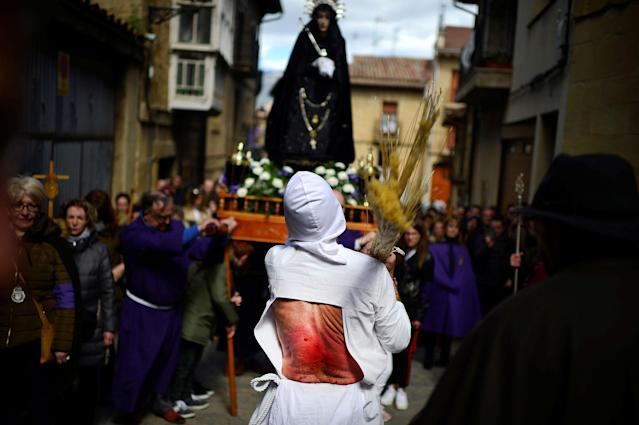"<p>A penitent from the Santa Vera Cruz brotherhood, known as ""Los Picaos"", whips his back with tied rope during Good Friday celebrations in San Vicente de la Sonsierra, La Rioja, Spain, March 30, 2018.(Photo: Vincent West/Reuters) </p>"