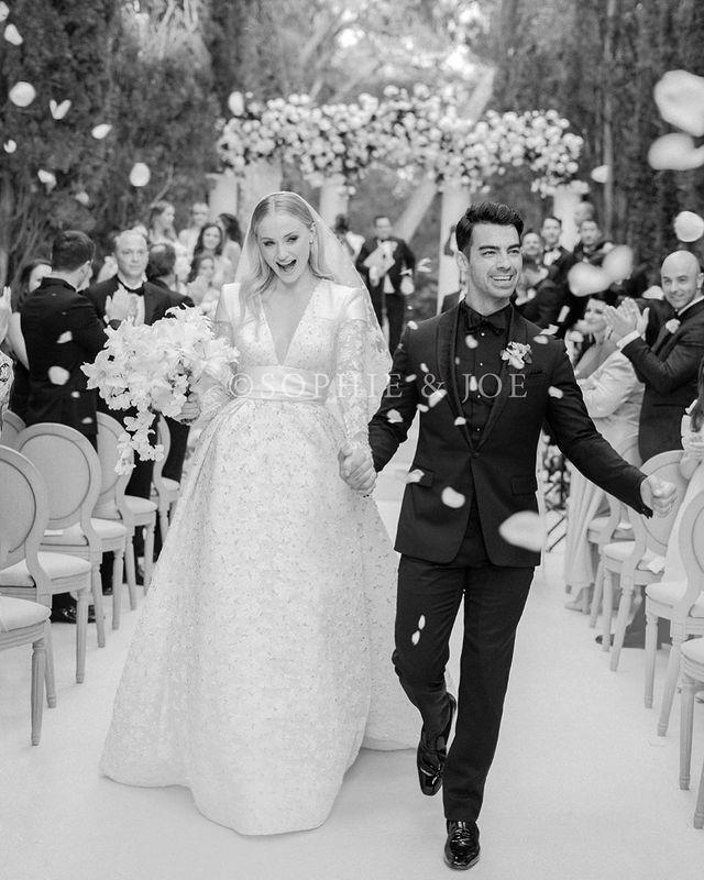 """<p>The <a href=""""https://www.elle.com/uk/life-and-culture/wedding/a28182548/sophie-turner-joe-jonas-wedding-dress-pictures/"""" rel=""""nofollow noopener"""" target=""""_blank"""" data-ylk=""""slk:Game of Thrones"""" class=""""link rapid-noclick-resp"""">Game of Thrones </a><a href=""""https://www.elle.com/uk/life-and-culture/wedding/a28182548/sophie-turner-joe-jonas-wedding-dress-pictures/"""" rel=""""nofollow noopener"""" target=""""_blank"""" data-ylk=""""slk:actress married beau Joe Jonas"""" class=""""link rapid-noclick-resp"""">actress married beau Joe Jonas</a> in a French ceremony <a href=""""https://www.elle.com/uk/fashion/celebrity-style/a28287910/sophie-turner-wedding-dress-pictures/"""" rel=""""nofollow noopener"""" target=""""_blank"""" data-ylk=""""slk:wearing a Louis Vuitton gown designed by Nicholas Ghesquière"""" class=""""link rapid-noclick-resp"""">wearing a Louis Vuitton gown designed by Nicholas Ghesquière</a>. The plunge-neck silk and lace gown featured a stunning embellished skirt, open back and lace sleeves.</p><p><a href=""""https://www.instagram.com/p/BzetyOqhAQq/"""" rel=""""nofollow noopener"""" target=""""_blank"""" data-ylk=""""slk:See the original post on Instagram"""" class=""""link rapid-noclick-resp"""">See the original post on Instagram</a></p>"""