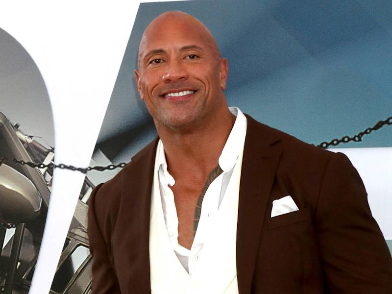 Dwayne Johnson and Danny DeVito crash wedding while promoting new movie