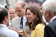 <p><b><b><b>The Duke and Duchess try a beer during a tour of a traditional German market in the central square of Heidelberg, Germany.<br><em>[Photo: PA]</em> </b></b></b></p>