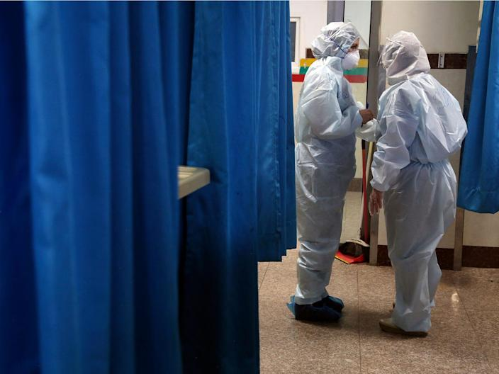 Paramedics in a ward for people infected with the new coronavirus.