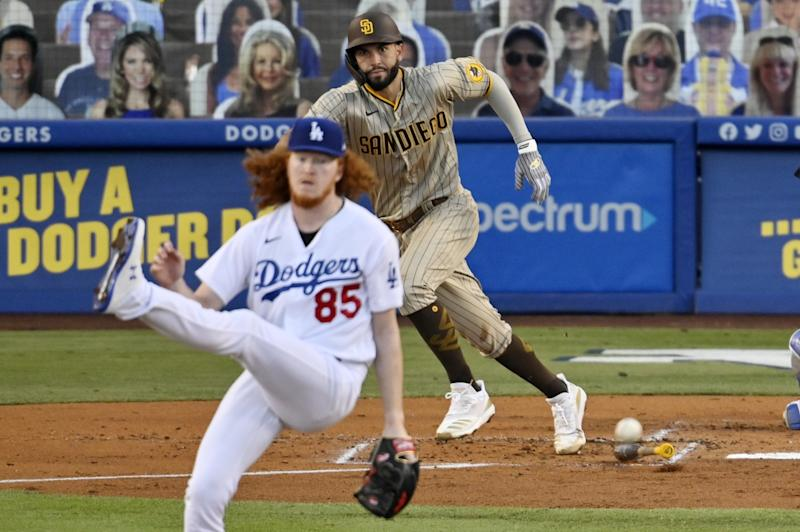 San Diego's Eric Hosmer sends a hit flying past Dodgers starting pitcher Dustin May during the second inning Monday.
